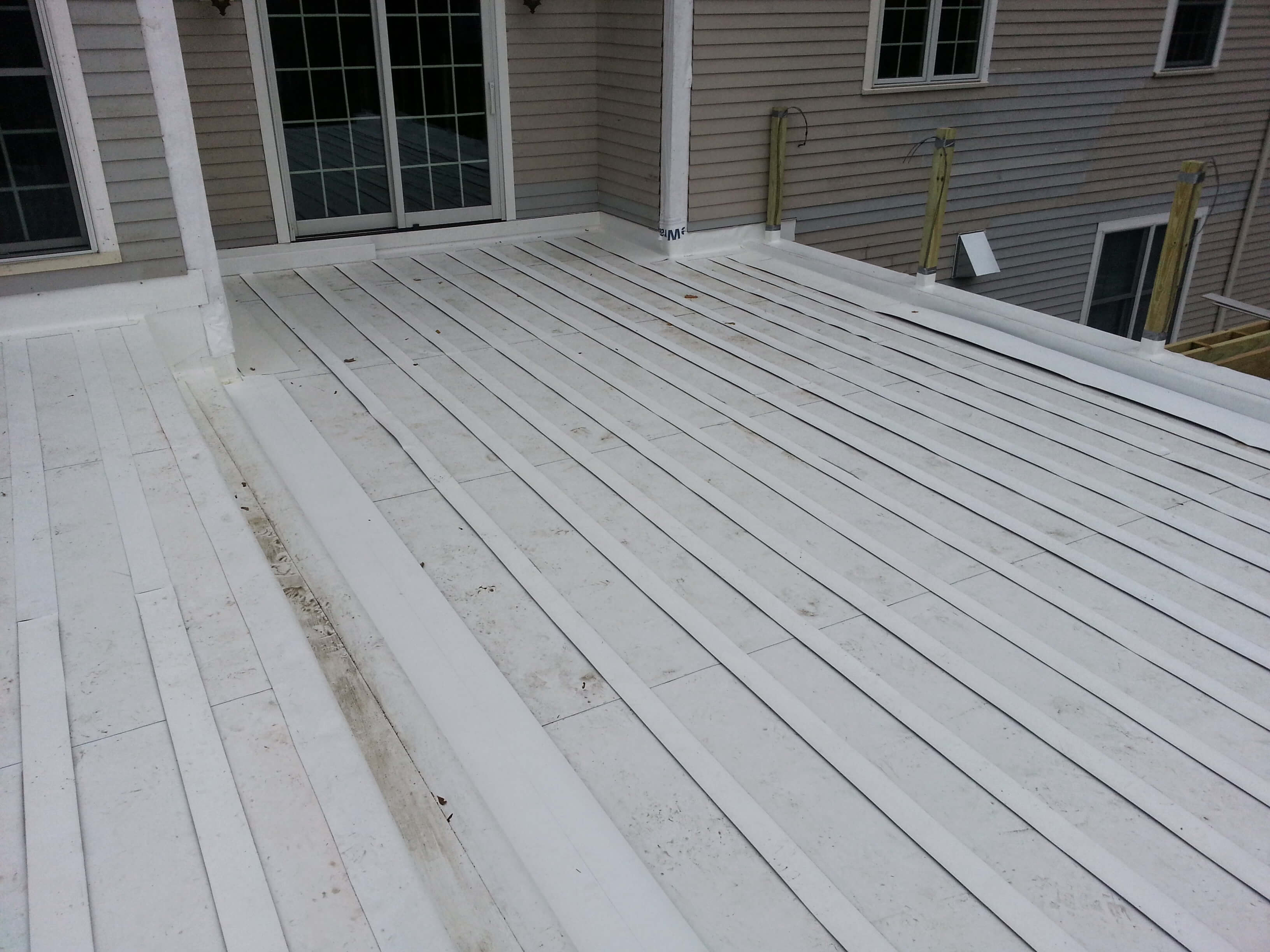Pvc Roof Installation Under Floating Wooden Deck In